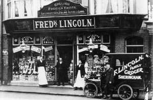 Photograph of the exterior of Fred Lincoln's shop, and shop workers, in the Victorian Era